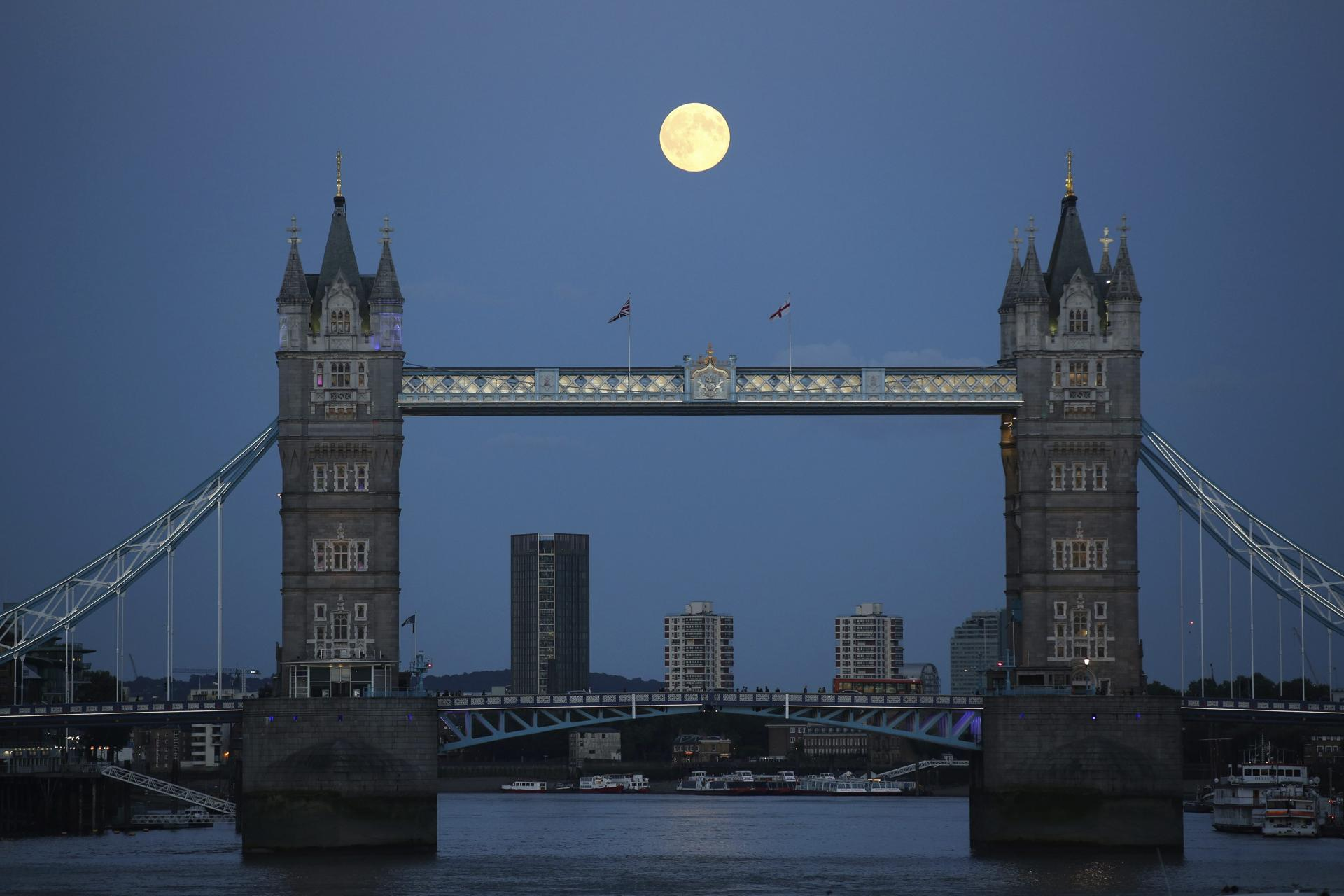 A supermoon rose over Tower Bridge in London.
